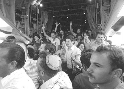 Freed hostages wave as they emerge from the aircraft (pic courtesy IDF Archives)