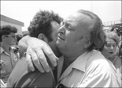 Two men hug as freed hostages are reunited with relatives (pic courtesy IDF Archives)