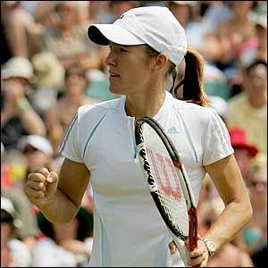 Justine Henin-Hardenne celebrates