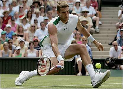 Max Mirnyi volleys at the net