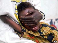 A girl undergoes female circumcision in Somalia