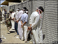 Suspected insurgents detained by Iraqi forces