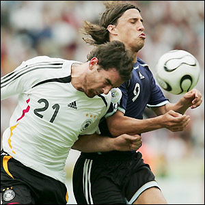 Christoph Metzelder heads the ball away from Hernan Crespo