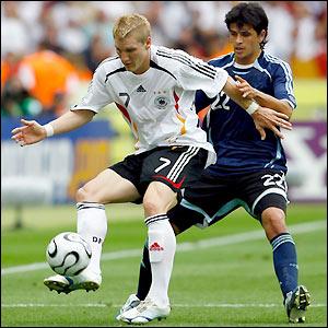 Bastian Schweinsteiger holds off Luis Gonzalez