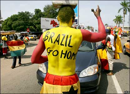 "Ghanaian football fan in Accra with ""Brazil Go Home"" painted on his back"