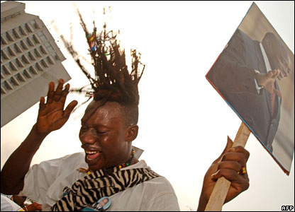 Joyous supporter of interim Congolese President Joseph Kabila