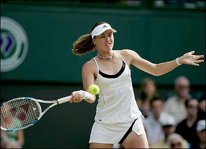 Martina Hingis plays a forehand