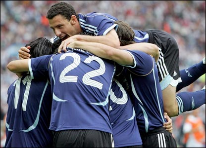 Argentina's players celebrate the opening goal