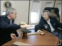 Bush and Koizumi on Air Force One, en-route to Memphis