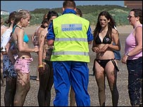 A coastguard officer talks to the rescued girls