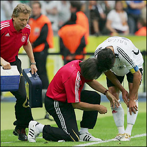Michael Ballack receives treatment