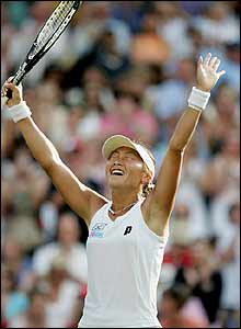 Ai Sugiyama celebrates her win over Martina Hingis