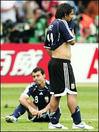 Argentina's Carlos Tevez and Javier Mascherano