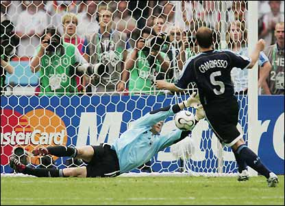 Lehmann pulls off his second save of the shoot-out to earn victory for Germany