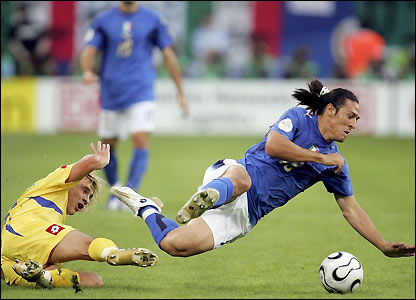 Mauro Camoranesi of Italy is brought down by Maksym Kalinichenko
