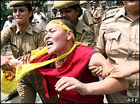 Indian police detain a man protesting against the new railway in New Delhi last Monday