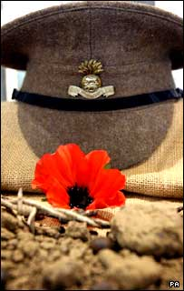 A cap and a poppy in a display cabinet at the Somme Heritage Centre in Newtownards, County Down..