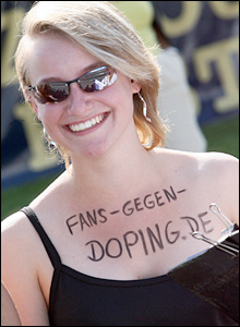 A cycling fan protests against alleged doping in the sport