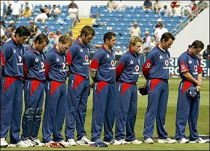 The England team bow their heads in memory Trueman