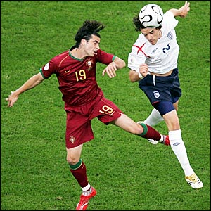 Owen Hargreaves (right) is busy in the holding midfield role for England