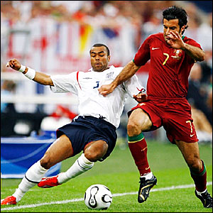 Ashley Cole (left) halts a Luis Figo run