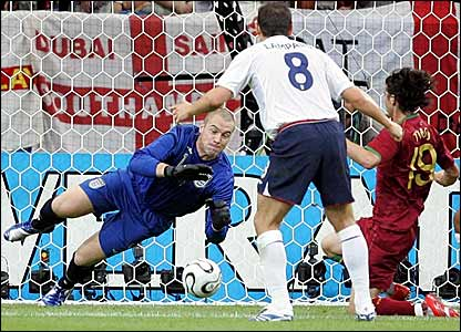 Paul Robinson (left) saves Tiago's (right) shot as Frank Lampard looks on