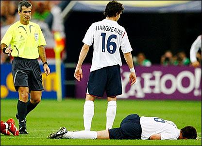 England's John Terry (right) lies on the floor awaiting treatment