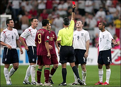 Argentine referee Horacio Elizondo shows Wayne Rooney (second right) the red card while other England players look on
