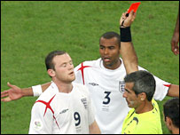 Wayne Rooney is shown the red card against Portugal