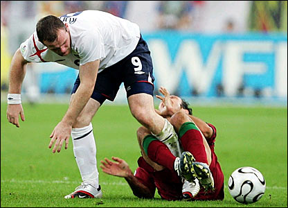 Wayne Rooney connects with a delicate part of Ricardo Carvalho's anatomy