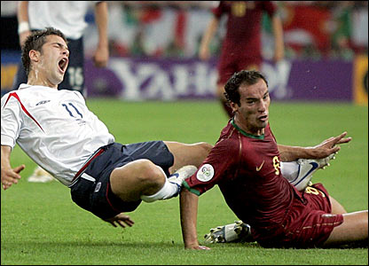 Joe Cole is fouled by Petit