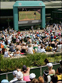 Fans bask in the sunshine at Wimbledon on Saturday