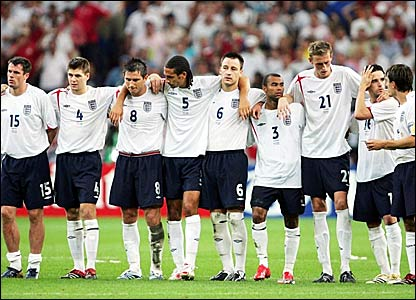 England players line up in the centre circle for the penalty shoot-out