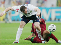 Wayne Rooney tangles with Ricardo Carvalho