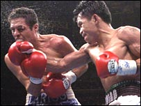 Manny Pacquiao (right) lands a right on Oscar Larios (left)
