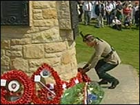 Wreath being laid at the cairn