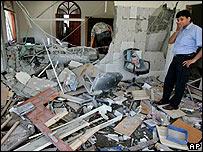 Officials inspect damaged building