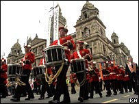 Marchers during an Orange parade in Glasgow on Saturday