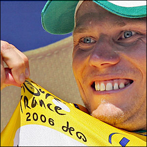 Credit Agricole's Thor Hushovd wears the yellow jersey after the first stage