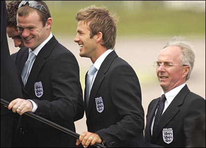 Rooney and Beckham board the plane with Sven Goran Eriksson