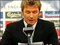 David Beckham reads from a statement in front of a news conference