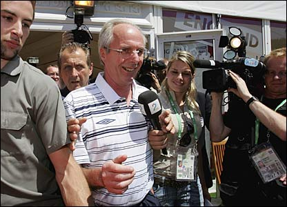 Eriksson is surrounded by journalists at the media centre