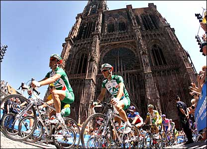 Riders pass in front of Strasbour cathedral