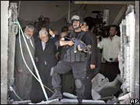 Palestinian Prime Minister Ismail Haniya (left) and Palestinian Authority President Mahmoud Abbas (2nd left) visit Mr Haniya's bombed office