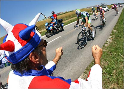 A patriotic Frenchman cheers on Credit Agricole riders