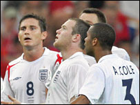Wayne Rooney and team-mates cannot believe he is shown a red card