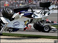 Nick Heidfeld's BMW Sauber somersaults out of the US Grand Prix after a multiple pile-up at the first corner