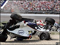 Nick Heidfeld's BMW Sauber somersaults as a result of a multi-car collision at the start of the US Grand Prix