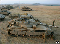 Israeli tanks and AFVs on the border