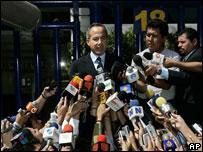 Conservative Felipe Calderon  speaks to the press after voting